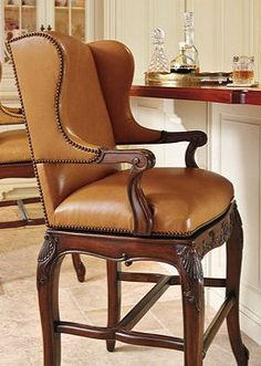 The comfort of a wing chair while seated at the bar.