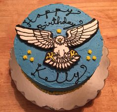 Bake a wish delivery for July 2015. 3 layer chocolate cake with blue vanilla icing -with a big eagle.