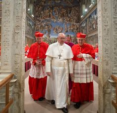 Pope Francis leaves the Sistine Chapel after being elected pope and shortly before appearing for the first time on the central balcony of St. Peter's Basilica at the Vatican March 13.