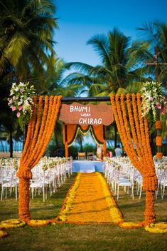 Love the marigold curtains with the name board center! <3 #Decor #gainda #indianWeddings | curated by #WittyVows the ultimate guide for the Indian bride | www.wittyvows.com