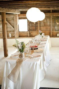 burlap runner on white tablecloths