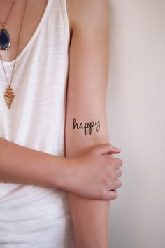 Two temporary typography tattoos with the word 'happy' by Tattoorary on Etsy