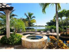 Amazing backyard with lake view, stone spa and pool - tropical paradise!  On Burnham Rd in Quail West | Naples, Florida