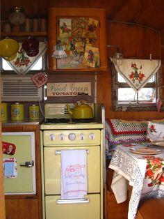 LOVE this kitschy vintage camper interior!