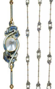 RENÉ LALIQUE - AN ART NOUVEAU MOONSTONE AND ENAMEL SAUTOIR, 1902-04. Composed of a series of cabochon moonstone links, each within a multicoloured enamel pansy surround, to the purple enamel baton-shaped chain, 152.0 cm, with French assay marks for gold, signed Lalique. #GoldJewelleryArtNouveau