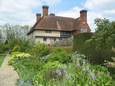 """By: 13th c. house renovated by Lutyens Location: Northiam, Rye, East Sussex Description: """"The gardens at Great Dixter were created in 1910 by English architect Edwin Lutyens, in the manner of cottage gardens on a grander scale. The gardens are set in the grounds of the manor house, first built in 1220 and added to in 1464. The house boasts an impressive timber-framed hall, one of the largest surviving in the UK. The Great Hall's roof with its oak frame and crown post, is of particular note…"""