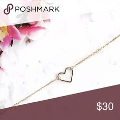 Dainty heart bracelet Dainty heart bracelet. Sterling silver gold plated over. Super cute. Very minimalist piece. Jewelry Bracelets