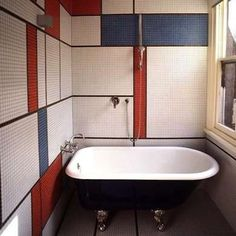 Wall Tile This narrow bathroom proves that even the tiniest functional spaces can exude style. Its geometric, Mondrian-inspired wall tiles create an eye-catching mid-century design. The claw-foot soaking tub adds an additional splash of personality