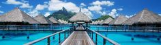 The St. Regis, Bora Bora,- When you arrive, the hotel's boat picks you up at the airport and whisks you away to your own over-the-water bungalow.  In its smart, creative kids' club, children can learn to make leis and batik prints and take lessons with the pastry chef.  You'll snorkel alongside turtles and a rainbow of fish in the loveliest water on earth - and you'll feel like you're on a second honeymoon (with the kids).