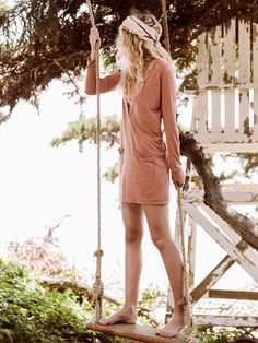 Bow Chicka Wow Wow Tunic | Lightweight heathered tunic in a lightweight fabric featuring a plunging V-neckline with front slip pockets and long sleeves. Raw, unfinished trim throughout. American made.