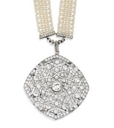 PLATINUM AND DIAMOND PENDANT-NECKLACE, CARTIER, PARIS, CIRCA 1915.  The articulated openwork pendant set in the center with an old European-cut diamond weighing approximately 1.30 carats, framed by old mine diamonds weighing approximately 7.10 carats, the pendant loop set with small rose-cut diamonds, signed Cartier, Paris, numbered 1314, together with a seed pearl necklace, accented by old European-cut and single-cut diamonds, length 23¼ inches, unsigned.