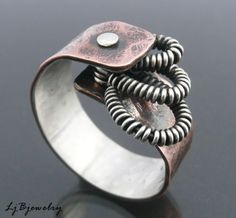 Ring | Laura Jan Bouton.  Sterling silver and copper.