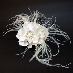 Ivory Facinator Bridal Hat. Wedding bridal hair piece with flower brooch, rhinestones, glass beads, French net. $82.00, via Etsy.