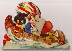 14. Boy in Indian feathers teddy bear  and GOLLIWOG in a canoe.jpg