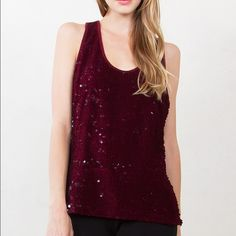The Velvet Sequin Tank TOP is NWT-Retail. Available in XS, S, M, L.      Glitzy, Glam, and GOOD! This tank is PERFECTION. Drenched in oxblood sequins it oozes lusciousness. Wear this tank with any and everything. It's literally your favorite tank!  Product Info: fully sequin tank sewn onto 65% polyester, 35% rayon blend, racer back w/ back gold exposed zipper, no lining. Tops Camisoles