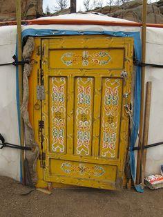 Yellow painted yurt door. Mongolia