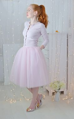 pink tulle skirt with matching pink cardigan