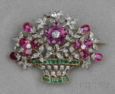 Edwardian Ruby, Emerald, and Diamond Flower Basket Brooch, France, designed as cushion-cut ruby blossoms in a basket with cushion-cut emeralds, and set throughout with old mine- and old single-cut diamonds, platinum-topped 18kt gold mount, lg. 1 5/8 in., maker's mark and guarantee stamps