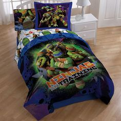 @Overstock.com - TMNT Stars 8-piece Bed in a Bag with Sheet Set - Decorate your child's room with this Teenage Mutant Ninja Turtles comforter and sheet set. This bedding set offers an exciting print in bright colors and includes everything you need to keep your little one comfortable at night. http://www.overstock.com/Bedding-Bath/TMNT-Stars-8-piece-Bed-in-a-Bag-with-Sheet-Set/7676463/product.html?CID=214117 CAD 134.63