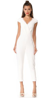 ac24269ab297 These sleek and chic bridal jumpsuits are perfect for a nontraditional  wedding