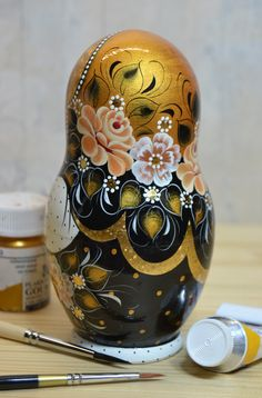 Russian nesting doll in black and gold design