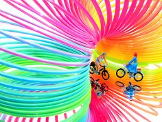 Cathy Scola, Project 366 - 9/4/2012 - 248/366 | Taking a bike ride under the rainbow. Two miniature figures on bikes under a slinky.