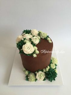 Cake for a friend's birthday. Chocolate buttermilk layer cake decorated with hand piped buttercream flowers.