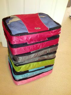 Organizing each family members winter essentials using packing cubes. Makes packing for a ski trip easy!