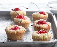 Cherry Tassies Perch bright red long-stemmed maraschino cherries in these tender pastry pouch cookies. bhg.com