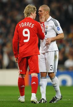 Fernando Torres of Liverpool clashes with Pepe of Real Madrid during the Champions League Round of 16 First Leg match between Real Madrid and...