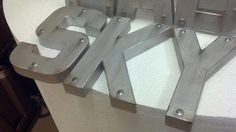 Add thumb tacks to the 3d letters before painting for a more industrial look
