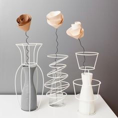 """Filueferru is a collection of six models of steel wire vases. The wire vase draws the space around a classic glass carafe, or around a vase made with ceramic, cement or aluminium. The name comes from """"fil' 'e ferru"""" in Italian named """"spirit of Sardinia"""", when spirit was produced clandestinely, the stills were hidden underground [...]"""