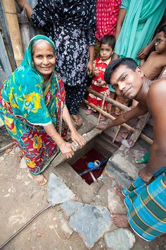 The Water Committee in Baisteki Slum in Dhaka, Bangladesh,  proudly show us the water meter for their freshwater project. (photo: Mo Scarpelli)