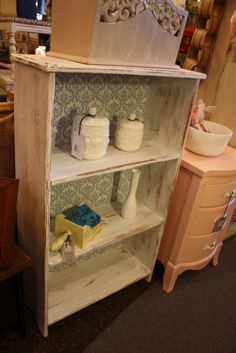 Annie Sloan Chalk Paint with Blue Damask Fabric on the back of Bookshelf
