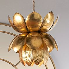 """Strike the eye with this beautiful lotus pendant in a gold leaf finish for a stunning accent in a powder room or a smaller space. 60 watt medium base lamp max.(15""""Hx15""""W)Supplied with 6' of gold chain and 5"""" round canopy."""