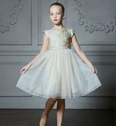 Cap Sleeve Dress--Made To Order - Ivory Embroidery Flower & Swarovski Rhinestones Applique Round Neckline Cap Sleeve Little Girl Party Dress. Perfect for Birthday, Wedding or any special day. Available from 4 until 15 years old. Material: purified cotton lining, spandex, tulle mesh. Please do compare your little girl measurements with our size chart below before deciding her size