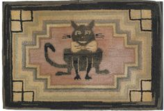 """American hooked rug, early 20th c., depicting a grinning Cheshire cat with a big bow tie in a stepped geometric border, 16"""" x 24""""."""