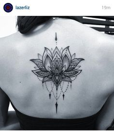 Black and gray dotwork lotus tattoo by @lazerliz