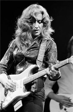 Bonnie Raitt - I've had the good fortune to meet her twice. I even have a photo very similar to this in my photography portfolio.