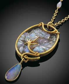 Carved Opal Pendant. Rene Lalique (1860 - 1945). Circa 1900. Carved opal, glass, gold. Pendant is 9cm long.