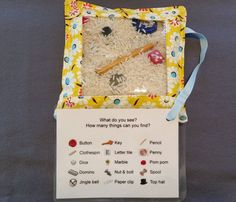 Fidget Bags are a great sensory stimulation activity for adults with Alzheimers or Dementia. Items and rice have been secured inside a cotton bag with a vinyl window to seek and find. A laminated tag lists 15 items to look for and easy to identify by picture. The tag is attached