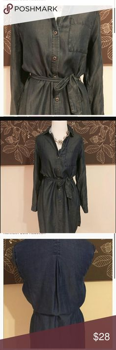 """Kenneth Cole Blue Chambray Shirt Dress Kenneth Cole Womens Blue Denim Shirt Dress. Long sleeves. This dress has never been worn. It is in excellent condition. This is a great dress for summer and can even work as a beach cover up! Adjustable long sleeves, pockets and the buttons has 'Kenneth Cole Reaction' on them.  It measures approx. 21.5"""" from armpit to armpit laying flat;  approx. 37"""" from center back of neck, below the collar, to bottom hem. Sleeve 25"""".  Please see all photos and if you…"""