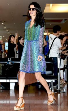 Live Colorfully from Amal Clooney's Best Looks  Always travel in style! Amal rocked a Missoni dress with Valentino sandals while arriving in Japan.
