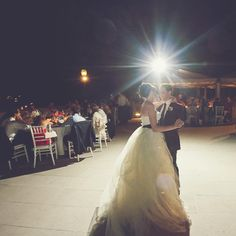"""The newlyweds' first dance was to Billy Joel's """"New York State of Mind,"""" a fitting choice. W. Scott Chester Photography."""