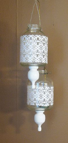 Easy to do..maybe put knobby top on a lid with fancy cut vents for heat..  Thinking maybe black instead on teal jars or jars clear jars colored with modge podge and RIT dye... Morrocan Lanterns: maybe Sara would like this DIY.