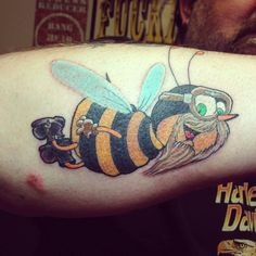 Demon tattoo on biceps for men demon tattoos for men for East coast tattoo body piercing