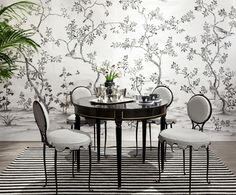 Celerie Kemble on Martha Stewart ~ Hand Painted wallpaper by Fromental, Rene Drouet chairs, Black lacquered demi-Lune table attributed to Jansen, belted stripe rug, and silver coffee and tea set. Photo by Hulya Kolabas. Black And White Dining Room, Black And White Interior, Black White, Hand Painted Wallpaper, Interior Decorating, Interior Design, Dining Room Table, Dining Rooms, Modern Room