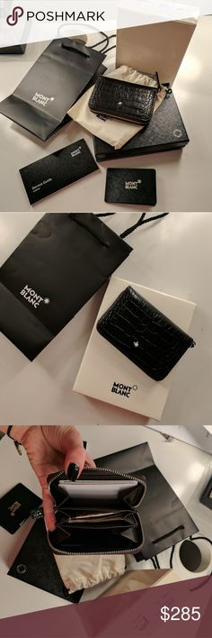 Montblanc black leather wallet Montblanc black leather wallet - barely used, no signs of wear - Includes box, dust bag and bag Montblanc Accessories Key & Card Holders