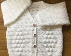 PDF Format Crochet Pattern for Babys/Childrens V Neck Cardigan 1004 For Double Knitting Yarn Using UK Terminology For Age: months to years To Fit Chest: 46 to to Double Knitting Baby Yarn: 2 x for smallest size to 4 x for largest. Crochet Hook and mm Crochet Baby Dress Pattern, Crochet Bebe, Crochet Baby Clothes, Chunky Crochet, Crochet Hooks, Crochet Patterns, Knitting Yarn, Baby Knitting, Toddler Cardigan