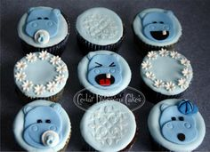 Hippo Baby Shower cupcakes - A selection of vanilla chocolate and red velvet cake cupcakes with fondant accents.